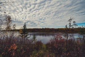 Lake with cloudy sky.