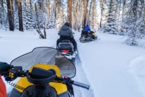 Snowmobiling in the woods.