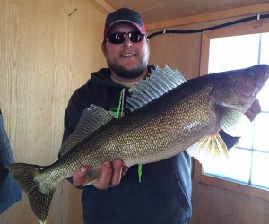 Paul holding a large walleye.